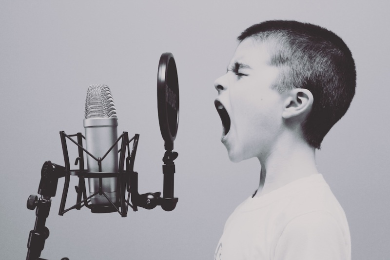 unsplash-kid-yelling-in-mic
